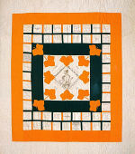 Presentation quilt, by the members of The Young Ladies Sewing (or Aid) Society, Canandaigua, New York, for Susan Elizabeth Daggett, 1871, 68 x 76 inches, pieced and appliquéd cottons. Signed in ink. Collection of the author.